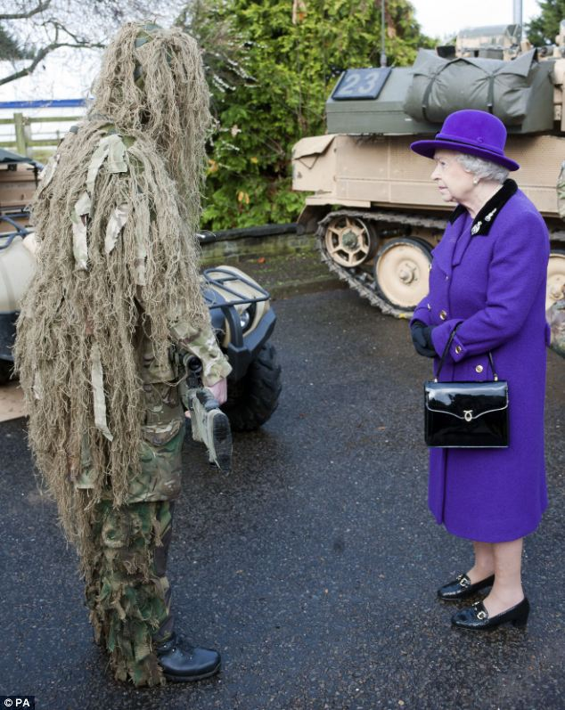 queen and camouflaged man.jpg